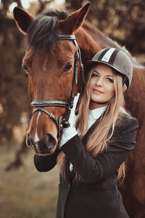sweet good: Blondie and beautiful horse.Stunning, gorgeous blonde woman with horse.Blondie, beautiful girl with nice, brown horse in park.Beautiful, long-haired, blonde, friendly, joyful, loving, sweet, good, kind girl with big, calm horse horseback outdoors in summe