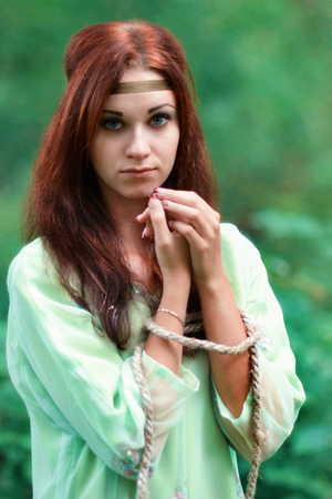 Red-haired upset, unhappy girl in big depression, tears, thinks about problems.Red-haired, cute, adorable, delightful, charming, beautiful girl with healthy, shiny red hair.Green.Red-haired upset, unhappy girl with blue eyes with connected hands