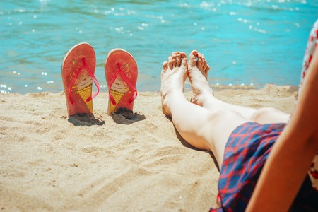girl on the beach with flip flops