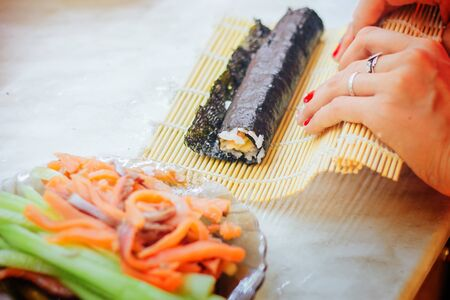 sushi rolls making hands at home