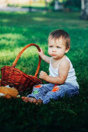 capricious: Quite extraordinary funny portrait of baby holding basket Stock Photo