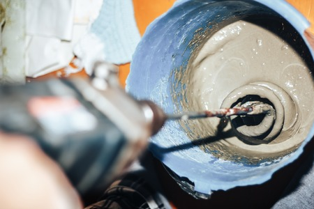 mixing Tile adhesive or cement with a power drill Zdjęcie Seryjne
