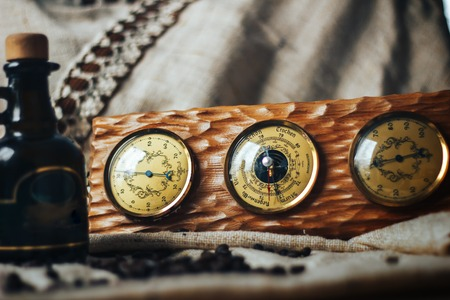 hygrometer: Retro wooden barometer with thermometer and hygrometer, shown against a weathered wood background with space for text. Stock Photo