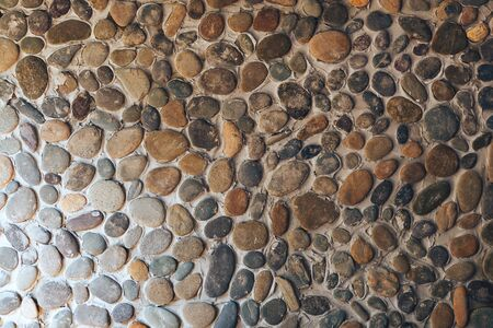 Background texture of different round stone wall. Imagens