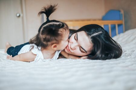 Lifestyle photo of mother and daughter at home