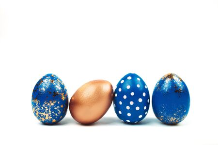 easter blue eggs standing isolated on white.