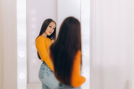 girl standing in front of mirror