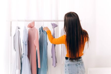 Girl chooses clothes