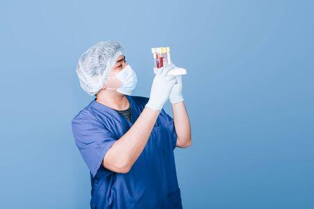doctor holding test tubes