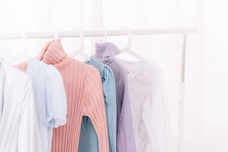 clothes hanging on hangers