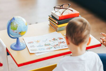 The child is studying at home, studying at home during quarantine, educational games for children, teaching gifted children, children of genius