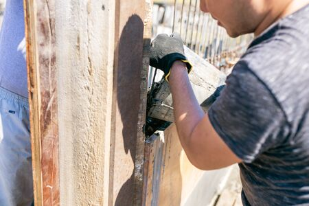 Work with cement mortar, pouring cement mortar wall, foundation and floor Stock Photo