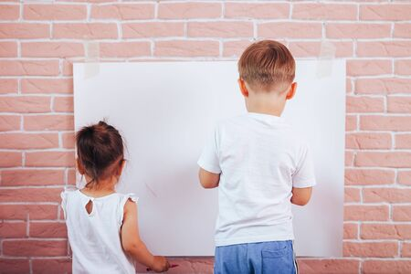 Little children draw on paper, home schooling, preschool education.