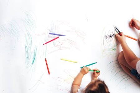 Talented children draw with colored felt-tip pens on white paper, lessons, tasks with children of the different ages.