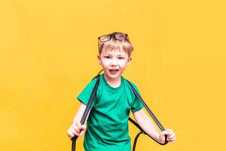 Back to school, little schoolboy posing on camera, the boy froze in surprise
