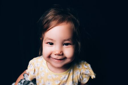 Smiling mixed nation little toddler girl looking at camera and smiling Banque d'images
