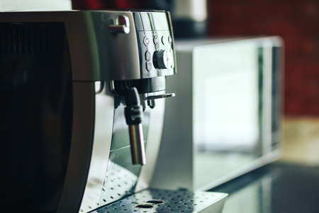 Close-up coffee machine, modern home appliances. indoor