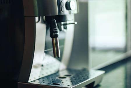 Close-up coffee machine, modern home appliances. sunlight