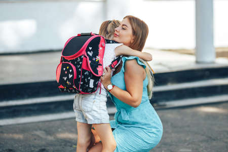 Mom escorts her child to school, back to school, knowledge day