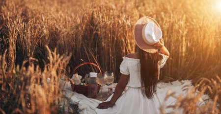 Picnic on a summer sunny day in a wheat field.