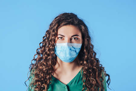 Young woman wearing a medical mask on her face during a pandemic