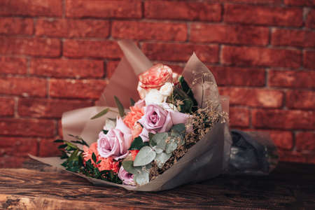 Big mix bouquet of different flowers on wooden background. 版權商用圖片