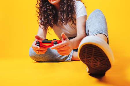 Woman playing video games, free time activity, new hobby woman during self-isolation, woman in e-sports.