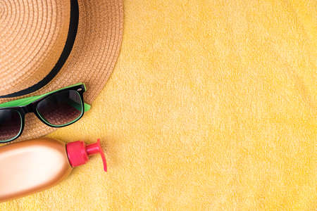 Summer supplies against yellow background. Summer vacation concept.