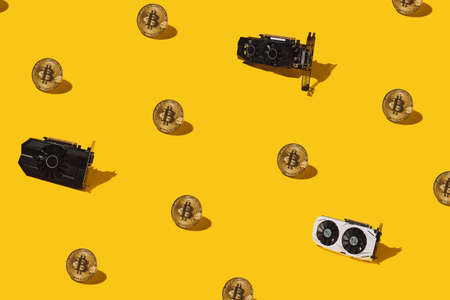 Golden pattern from bitcoin cryptocurrency and video cards. Cryptocurrency mining concept.