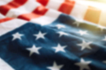 Blurred american flag background with sunlight. Fourth july concept.