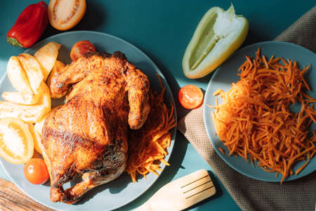 Freshly grilled chicken with vegetables and carrot salad.