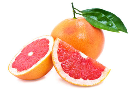 Juicy, ripe grapefruit with green leaves