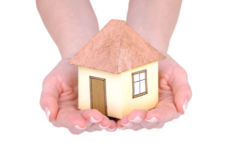 Paper house in the young woman hands Stock Photo - 6708962