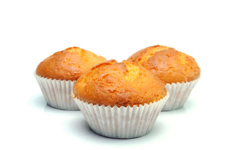 muffins: Three muffins on the white background Stock Photo