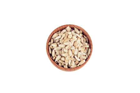 hulled: Sunflower seeds in the wooden bowl on the white background
