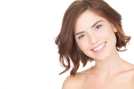 unblemished: She is perfect. Studio portrait of a gorgeous young female smiling to the camera