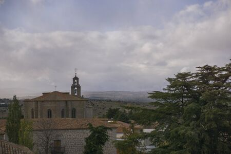 view of the bell tower of the church of san pedro in avila, spain