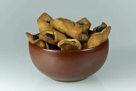 stoneware: brown, stoneware bowl with jam filled cookies Stock Photo