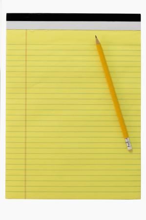 Geel schrijven bock met potlood Stockfoto