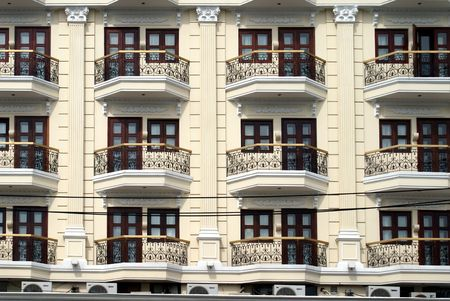 facade of a multi-storey apartment building with balconies photo