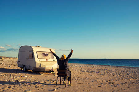 House on the wheels Camper van on the seaside, travel in vacation