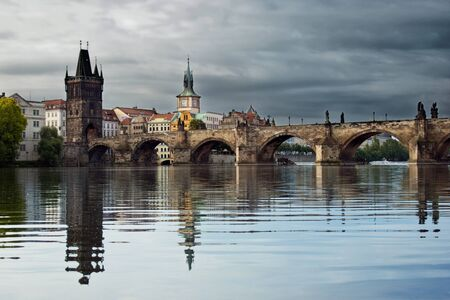 Charles Bridge with reflection in thу morning photo