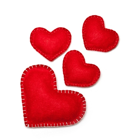 Felt red hearts isolated on a white background photo