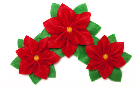 Three felt poinsettias-  symbol of christmas isolated on a white background. photo
