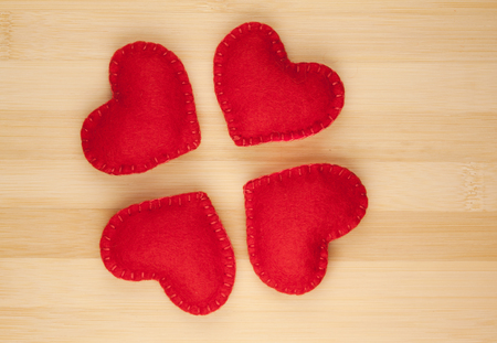 Small red hearts on a wood background photo