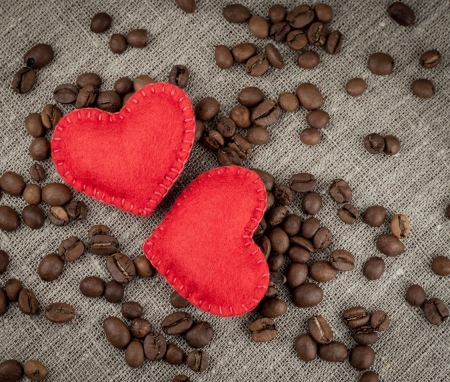 Red hearts on coffee beans background. photo