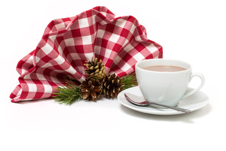 Cup of hot chocolate and table decorations for christmas photo