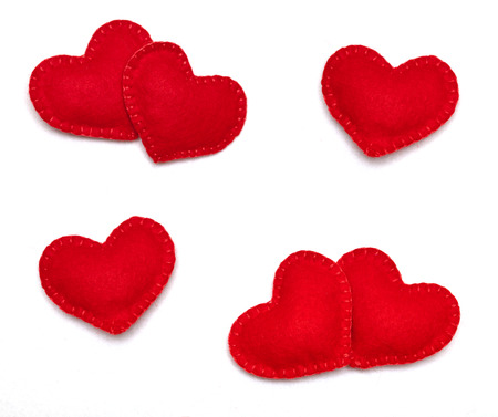 Small red hearts isolated on a white background photo