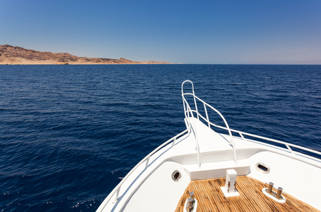 deck: View from sailing yacht in the sea in summer. Stock Photo