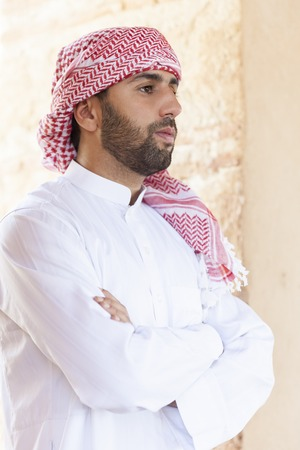 traditional clothes: Young upset handsome arabic man wearing traditional clothes